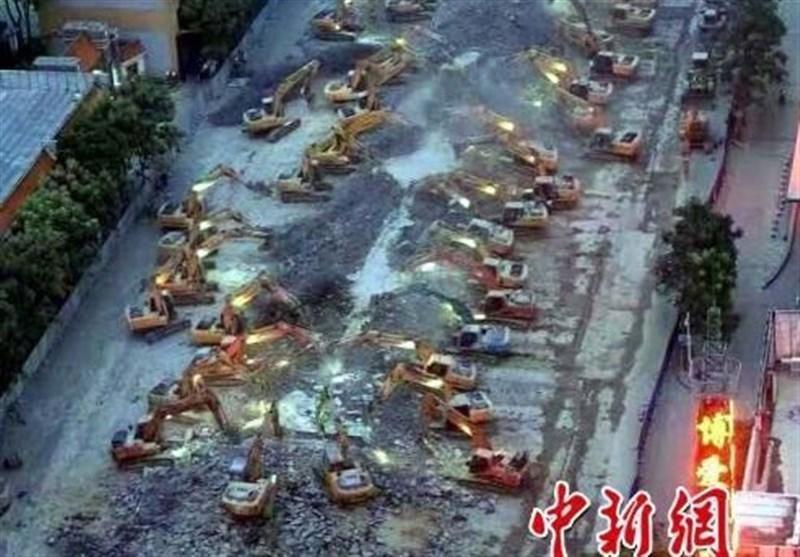 ماراتن تخریب شبانه یک پل در چین با حضور 100 بیل مکانیکی